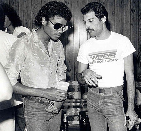 Michael Jackson and Freddy Mercury chatting at a party.